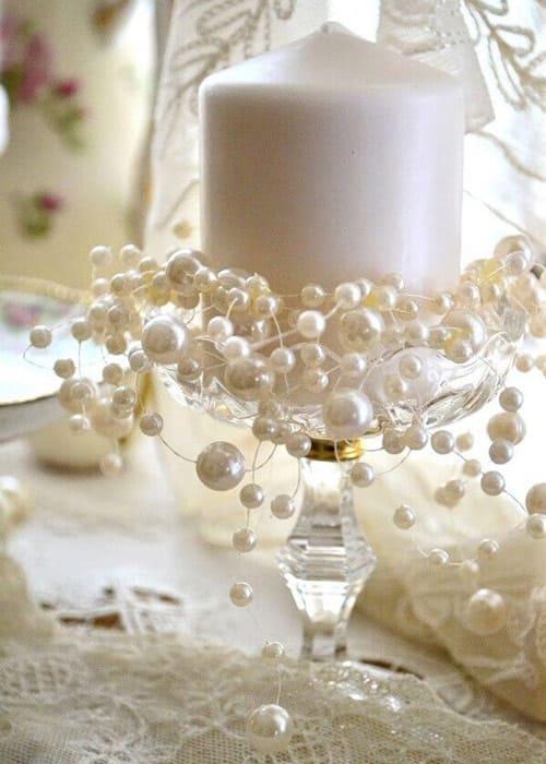 Kristallleuchter mit Perlen und Kerze